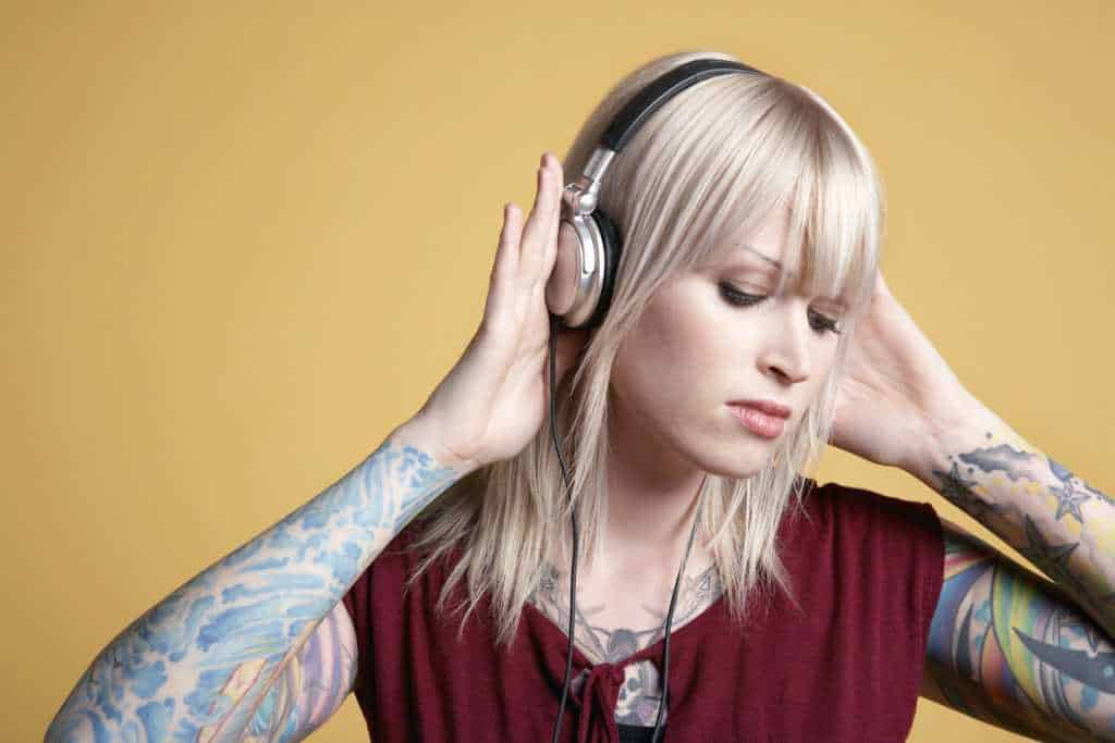 why do djs like to wear headphones?