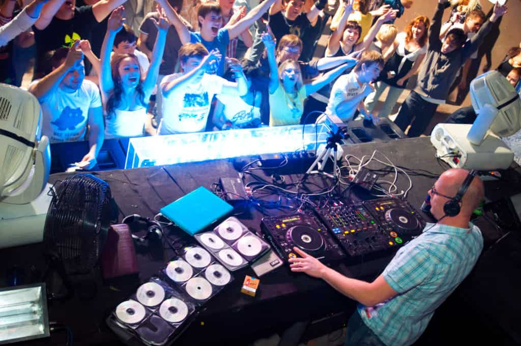 a dj using a controller at a gig.